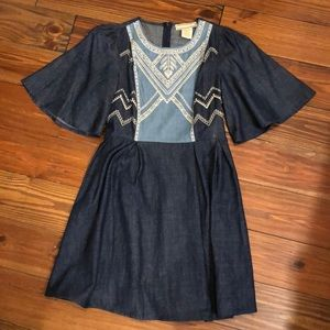Denim Dress with beautiful embroidery at the top.
